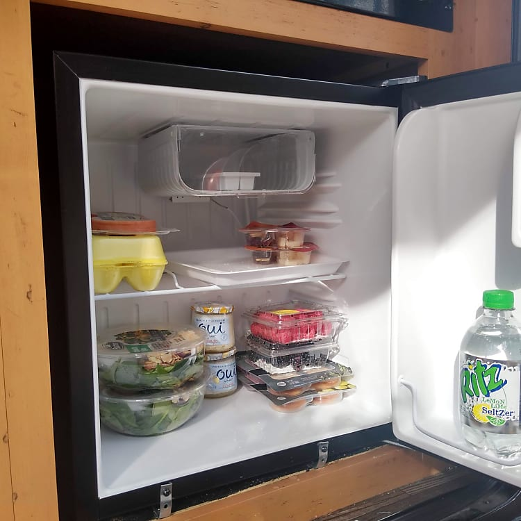 The mini fridge is a good size to hold small items, condiments, and some beverages. A cooler will still be needed depending how much food you are bringing and the size of the items.