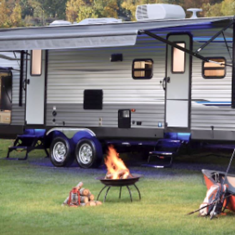 This is a stock photo, but it shows the awning, blue exterior LED lights and kitchen set up and ready to cook! (*note: our model does not have two exterior doors as shown here, scroll through pictures to see our beautiful rig!)