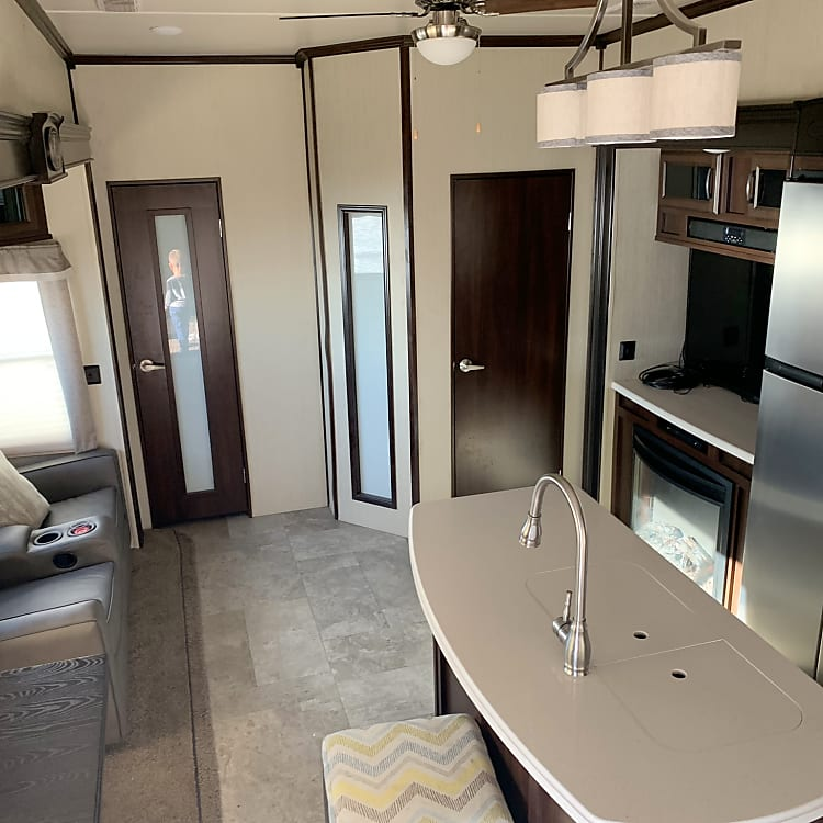 Dinette with extending table, theater style reclining sofa, big screen TV with 25' hdmi cable, double wide refrigerator.
