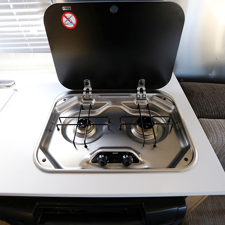 2-burner cooktop and sink. Although, we prefer to cook outside.