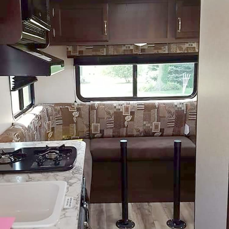 Kitchen and dining/entertaining area. This RV has tons of Windows with natural light.