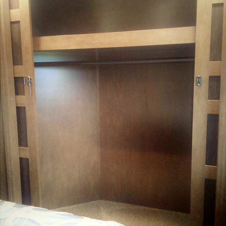 Large closet to hang up cloths as well as six drawers for storage