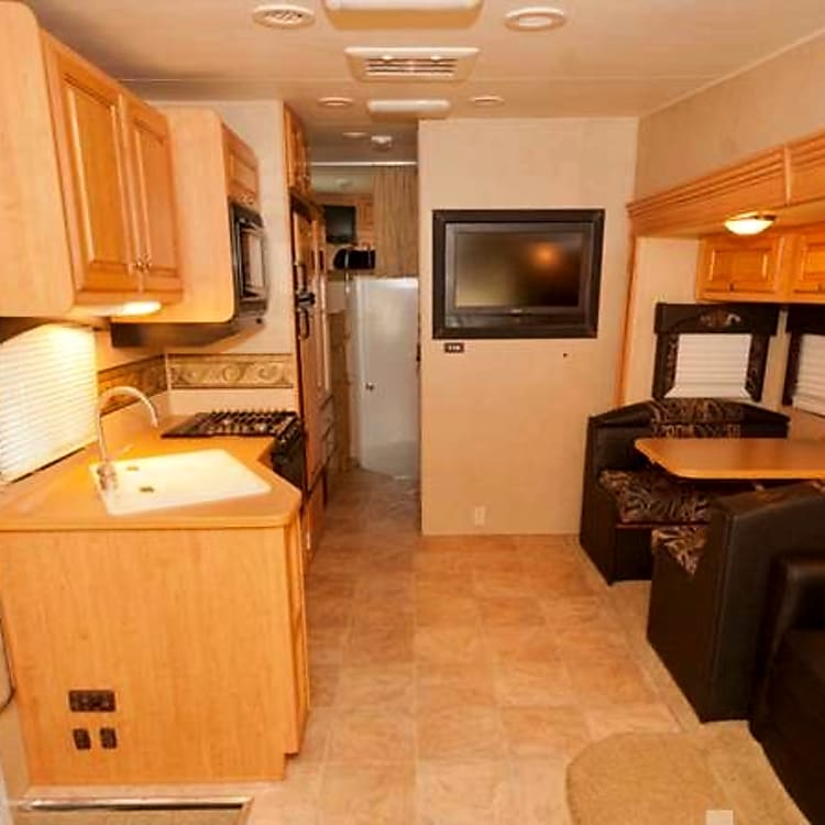 Rv has 5 TVs , one in each bedroom, 2 in the main area and one outside entertainment center.