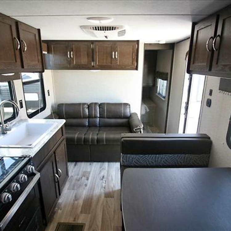 The bedroom in the back has a door that shuts it off from the rest of the trailer. The bed in it is Queen size. The AC is in the ceiling and the heat is central heat.