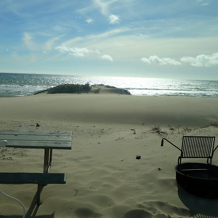 View while sitting inside the dinette slide looking out onto Jalama Beach.
