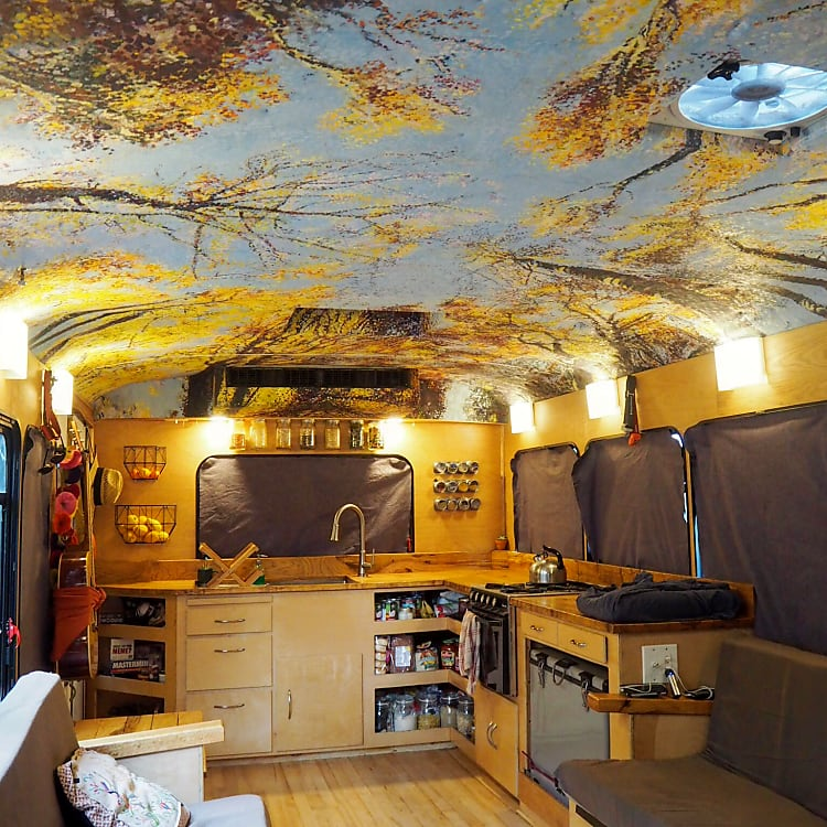 Custom artwork and an open floor plan make the interior feel pretty spacious.