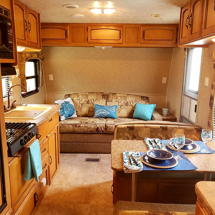 couch folds into double bed, dinette folds into twin bed.