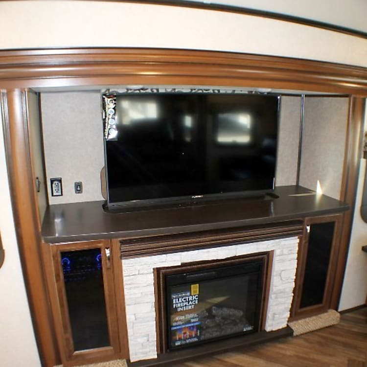 "50""  Retractable TV, DVD/CD/Surround Sound System and Electric Fireplace"