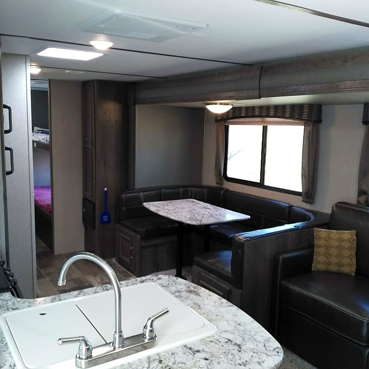Very spacious.  Wrap around dinette.  Double pull out couch bed.