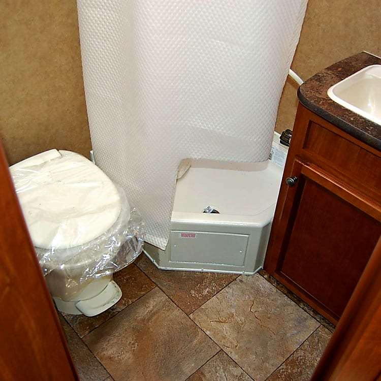 Bathroom with toilet, sink and shower