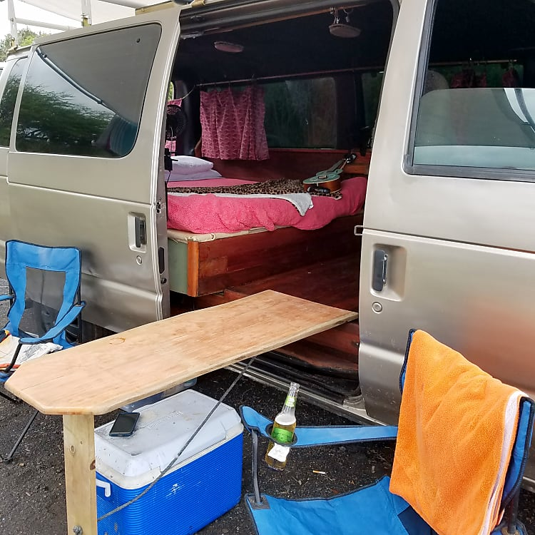 Queen size foam mattress, custom wood table, folding camping chairs, plenty storage, propane stove, ceiling fan vent w 2 additional fans, stereo w/  Deep cell camping battery.