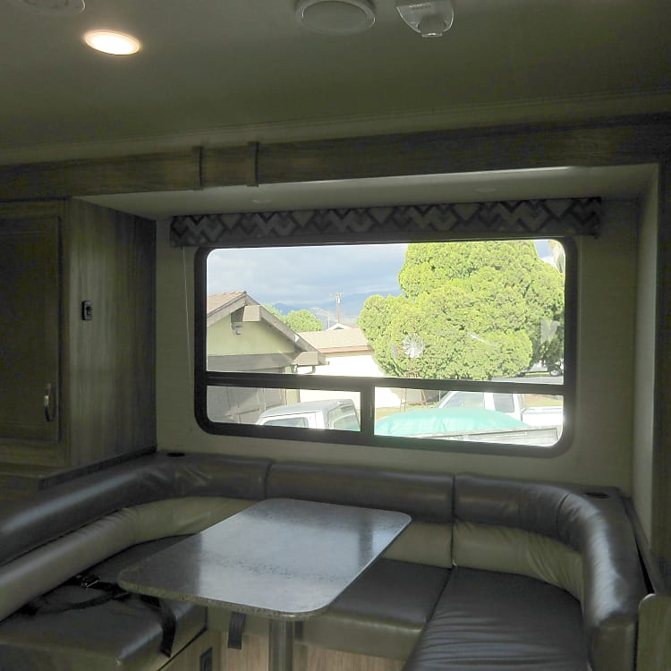 From the entrance view of the dining area of the RV.  When parked the dining area allows for more space by pressing a button to expand this space outward.