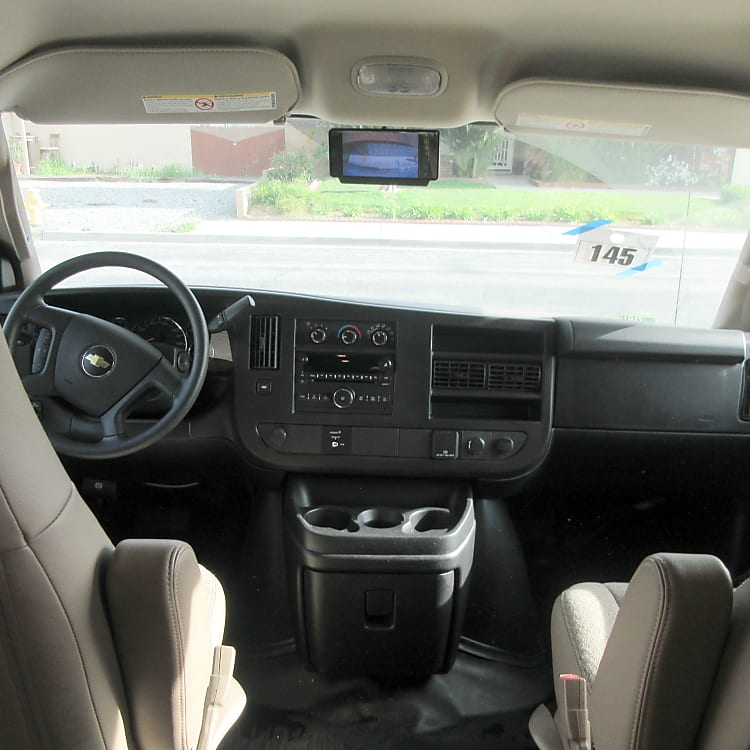 Driver and passenger area.  RV is equipped with rear view camera.