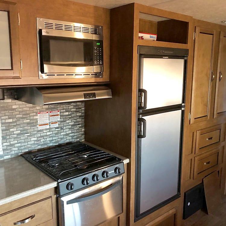 kitchen - fridge,sink and stove