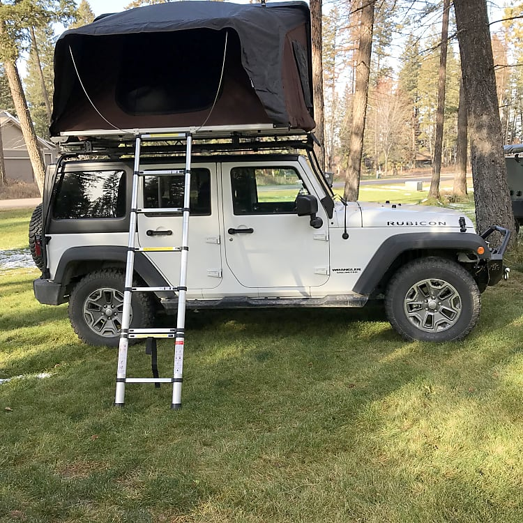 Our Jeeps come equipped with iKamper roof top tents.  Simple to open and just as easy to close.