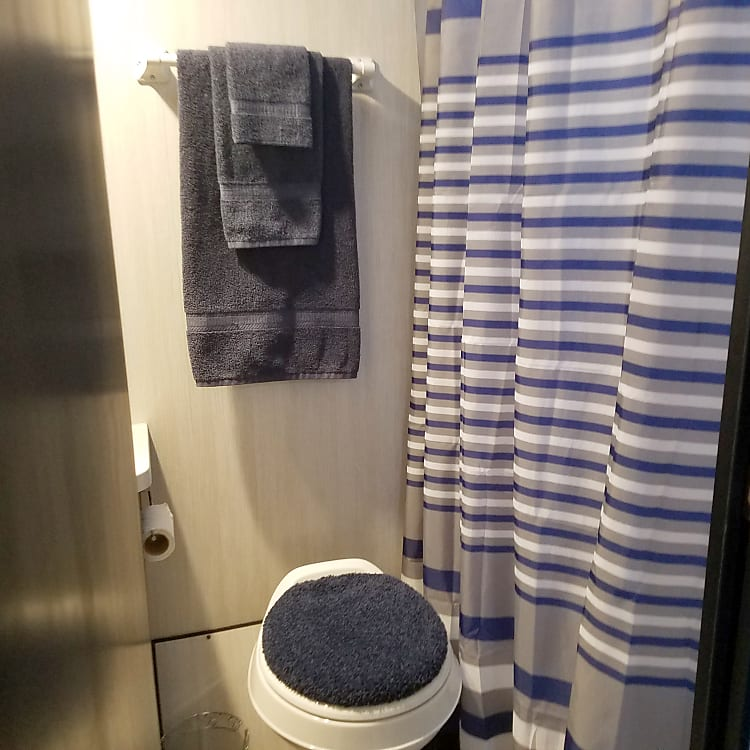Full bath with skylight above shower.  Towels and wash cloths for 4 provided.
