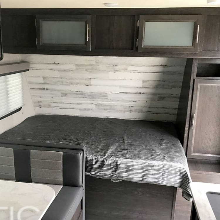 Queen size bed that offer plenty of room for couples and critters!
