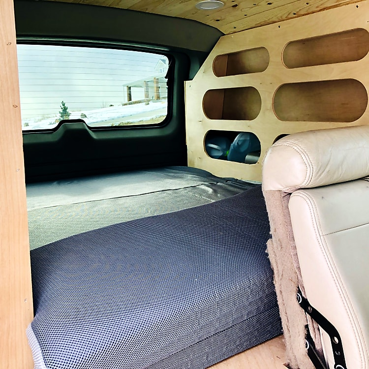 Looking from the rear passenger door toward the bed