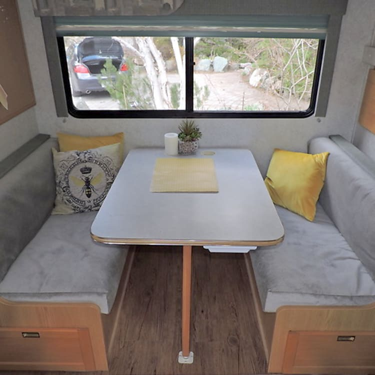 New upholstery on dinette/table becomes bed and storage under seats