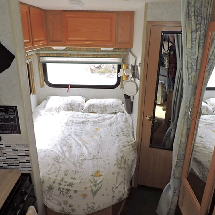 Rear queen bed with firm mattress, lots of cupboard space and bright rear windows