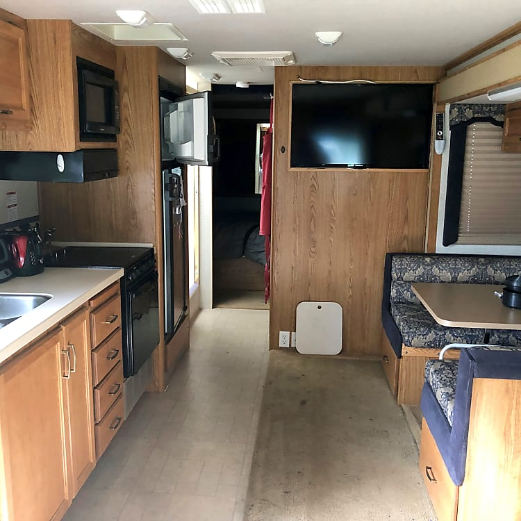 Living space, 48 inch screen tv, sink, range, stove, microwave and two phase refrigerator