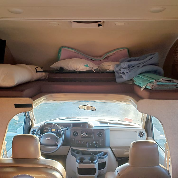 Bunk above cab with room for two adults, great spot for the kids. Fold out LCD TV is also tucked away on the left side.