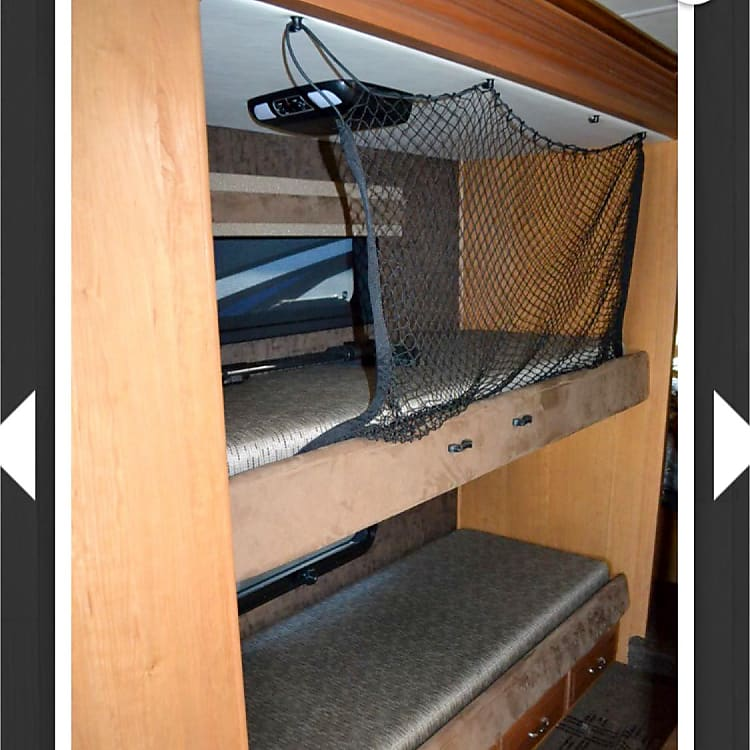 bunk beds with personal DVD players and headphones