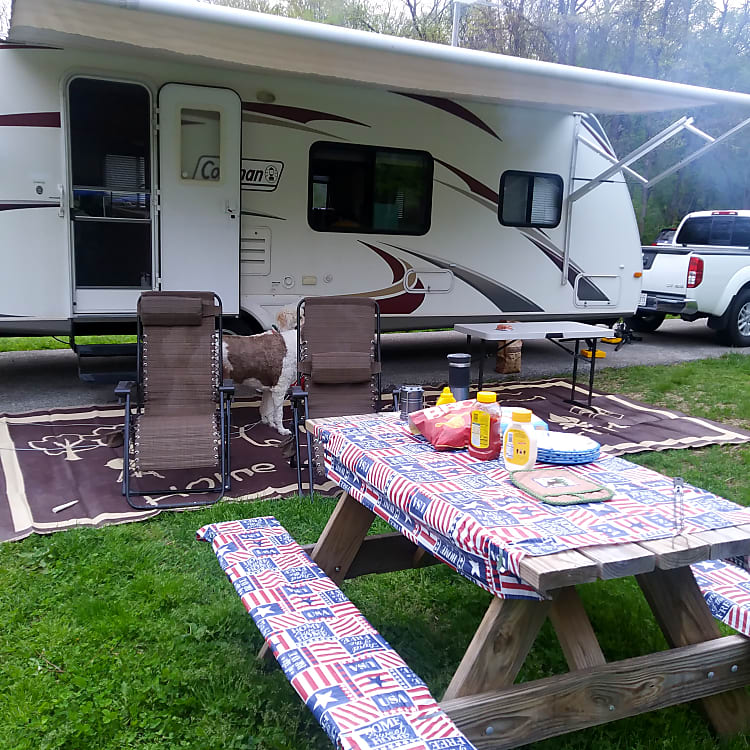 set up ready to enjoy the trip. 4 chairs, table cloths, table, rv mat