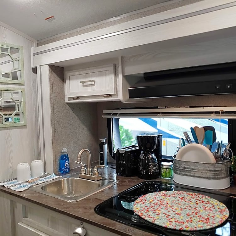 The cozy kitchenette has a 3 burner gas stove, kitchen sink, nice size refrigerator, toaster, coffee maker, small pantry for your dry goods and/or storage.  The kitchen is set up to serve four just like the comforts of your own home.