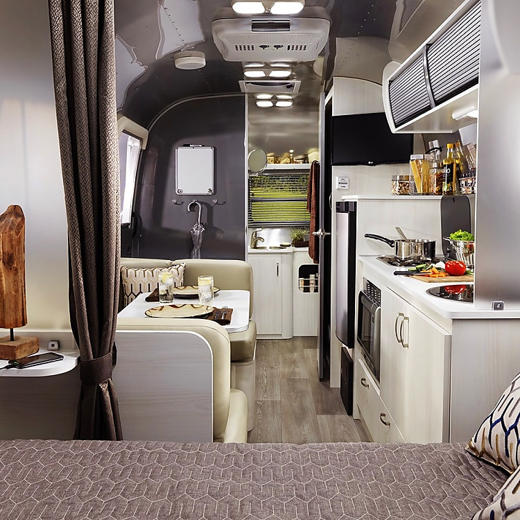Beautiful interior finishes and stocked with all you need for an outdoor adventure. Bluetooth sound system, solar, full kitchenware, bath and bed linens.