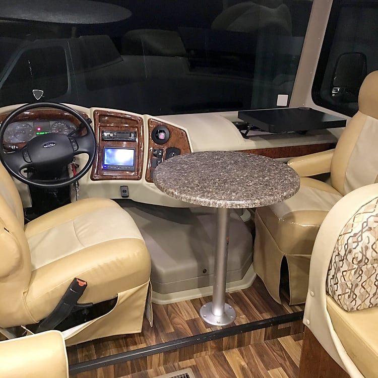 Driver and passenger area with table setup.