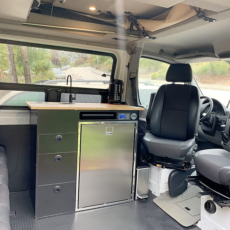 Very clean and functional interior; swivel seats, kitchen, seatbelts for 6.