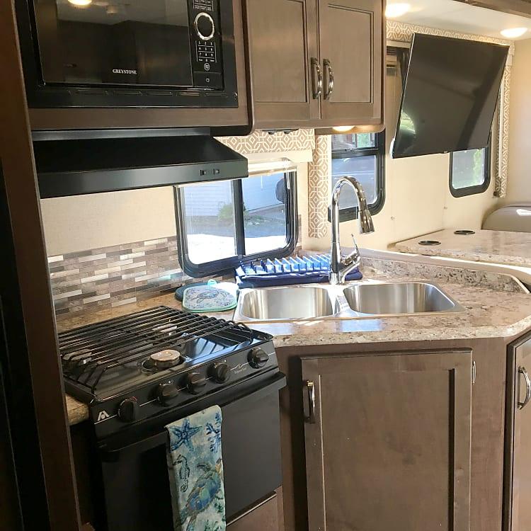 Kitchen: oven, range, microwave, double sink