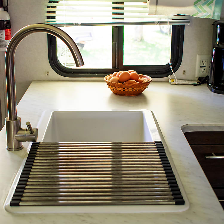 Double sink with drying rack.