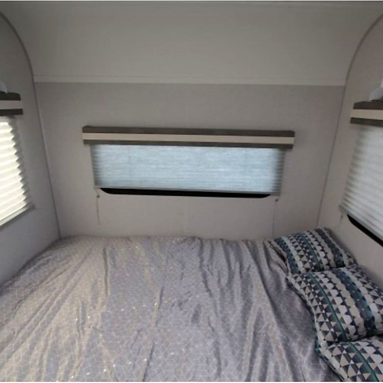 Rear sleeping area is a short queen with lots of windows, and I've added blackout curtains to provide privacy from the rest of the camper.