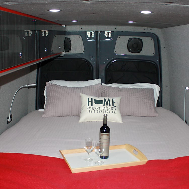 """Darkened sleeping area. The bed is 6'5"""" from windows to end of bed."""