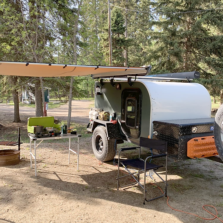 Our trailers can be equipped with ARB awnings (8x8), additional camping chairs, table, stoves and food coolers.