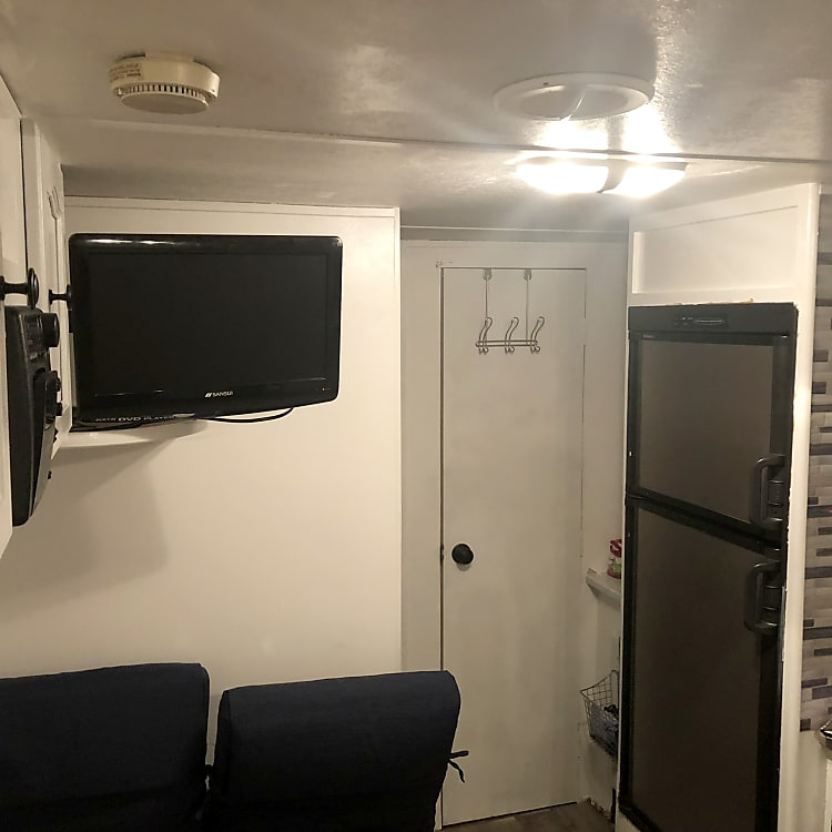 """Nice basic camper, 42"""" tv you can hang out on the outside, 19"""" tv with dvd on the inside, twin bunk beds, 1 queen, a bike that comes with the camper as well, air condition works Great and I mean great. It comes out strong and cold, 2 air gas tanks if you need to use, grill is on board to set up outside, 2chairs on board as well. Please ask if you have any questions. PET FRIENDLY Please no smoking inside."""