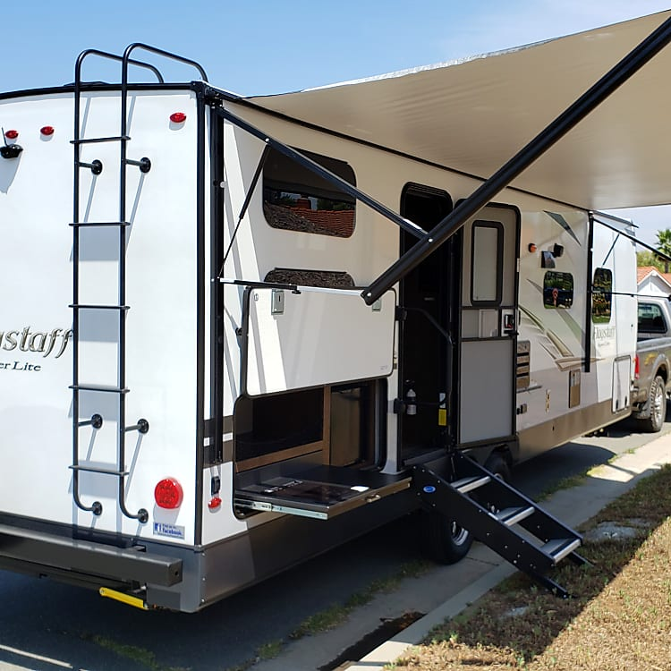 Huge 21' awning and outdoor kitchen with induction cooktop, also has propane bbq