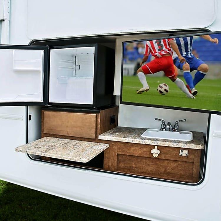 Outdoor tv, sink, fridge, cutting board, etc.