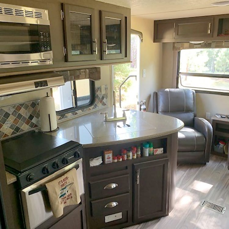 Great kitchen space that shares a big window and recliners! Kitchen has a all the necessary cooking equipment.