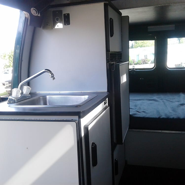 This camper van has (almost) everything, including the kitchen sink.