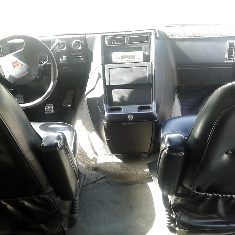 Front leather seats swivel 180 degrees.  Dash is in great shape.