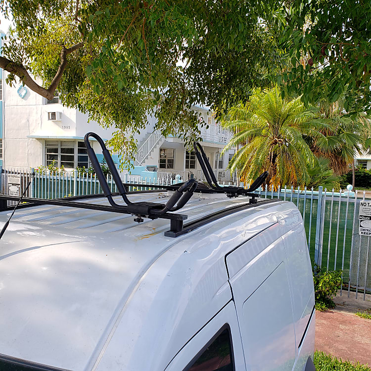 Paddle board and surfboard mounts. Holds up to 2.