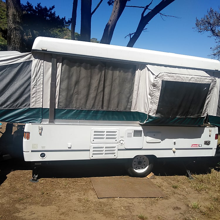 Awesome pop out kitchen gives TONS of extra room inside! This camper also features 2 custom dirt bike racks 1 on each end! Can also be used for extra storage for your cooler, generator, and/or extra camp wood!
