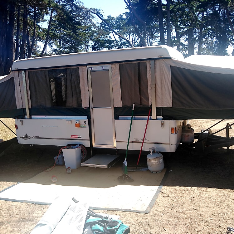This comfy front of the trailer has a step down and up into the camper, a place for an outdoor stove (included) Also included 2 outdoor rugs and 2 indoor rugs to help you (and us) keep the space clean !