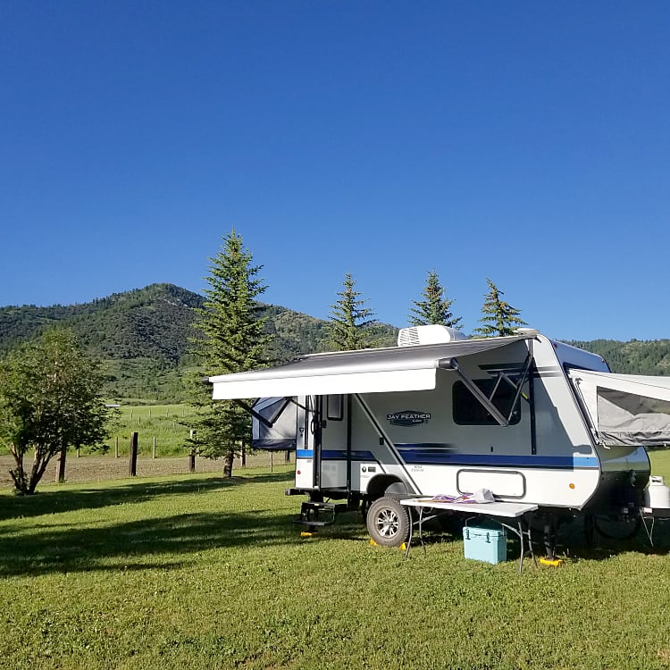 Camp set up in Swan Valley, ID with the solar panel soaking up some rays to keep the battery juiced up!