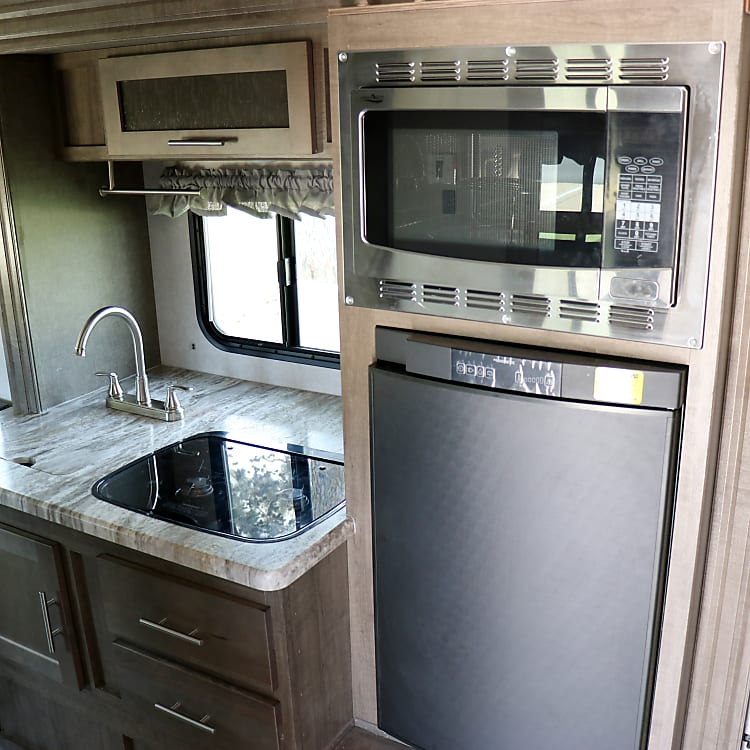 Full kitchen with fridge, microwave and convection oven.