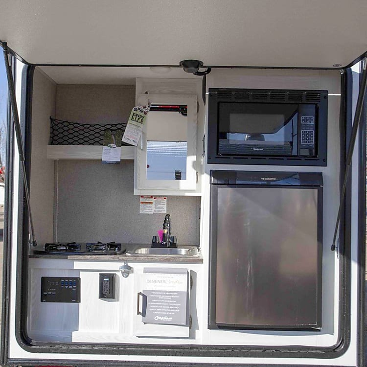 Outdoor Kitchen with large fridge, microwave, and stove