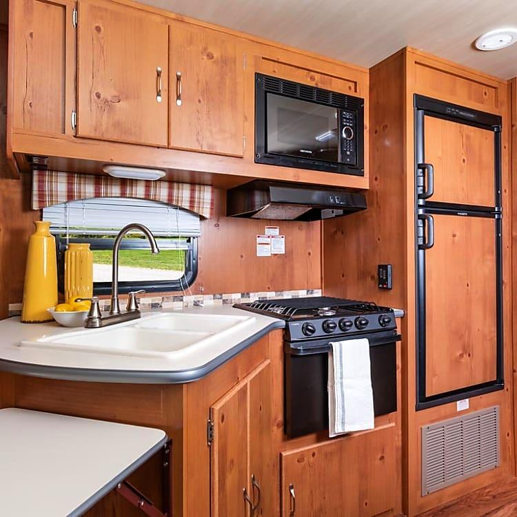 Microwave, Propane Stove, large refrigerator